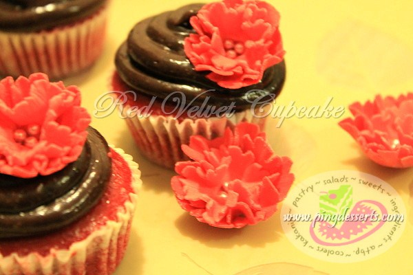 red velvet cupcake with chocolate frosting