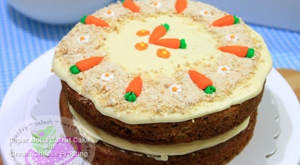 carrot cake with cream cheese frosting and ground cashews (2-layer)